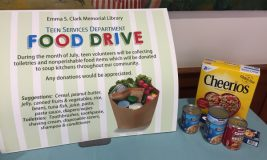 Food Drive sign and canned goods