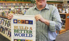 "Mr. Brian with a ""Build A Better World"" Summer Reading Bag"