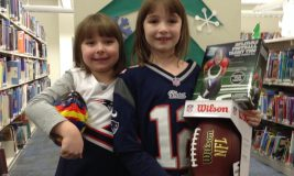 Winner of the 2017 Super Bowl Saturday raffle, Emma, and her sister Hannah.
