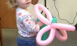 Little girl with balloon animal at last year's Take Your Child to the Library Day
