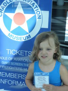 Girl at Cradle of Aviation Museum with Museum Pass