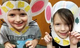 Two kids with mice craft from Fact and Fiction Story Time