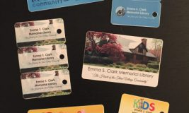 New library cards laid out on table