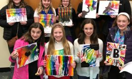 """Teens with their finished """"melted crayon art"""""""